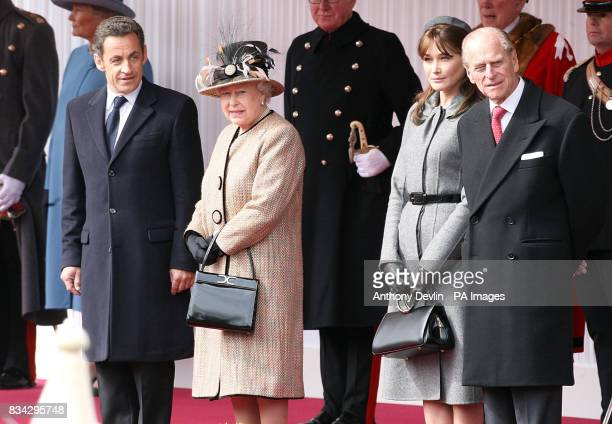 Queen Elizabeth II and the Duke of Edinburgh meet French President Nicolas Sarkozy and his wife Carla Bruni as they arrive at Windsor Castle