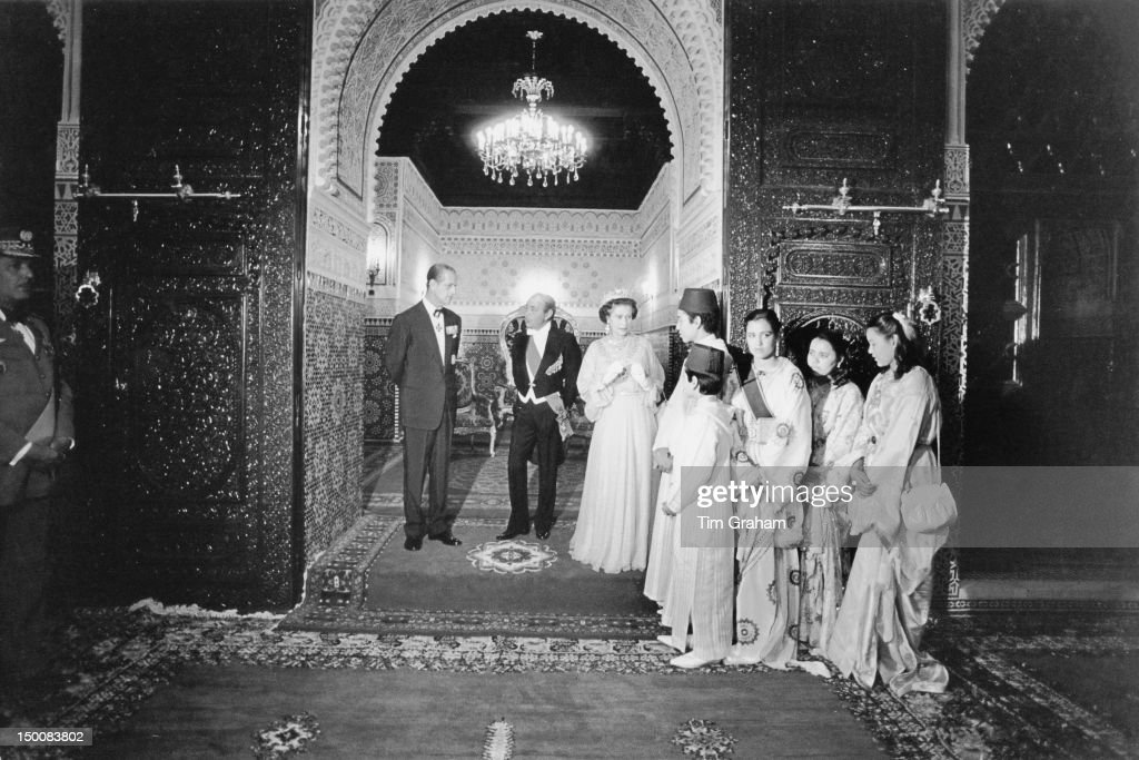 Queen Elizabeth II and the Duke of Edinburgh meet the family of King Hassan II (1929 - 1999) at the royal palace in Rabat, during a State Visit to Morocco, 28th October 1980.