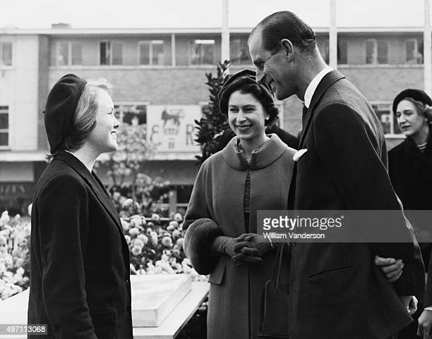 Queen Elizabeth II and the Duke of Edinburgh on the roof of a restaurant in the Stone Cross market square during a visit to Harlow England 30th...