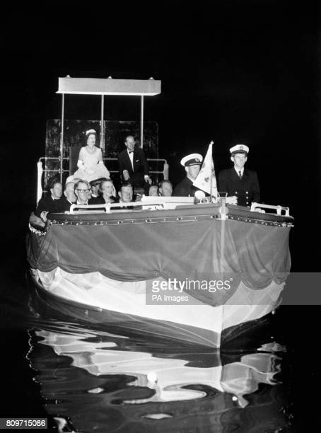 Queen Elizabeth II and the Duke of Edinburgh on the Royal barge carrying them across Torrens Lake, Adelaide, to attend a music festival in Elder Park.
