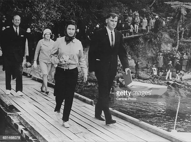 Queen Elizabeth II and the Duke of Edinburgh return to the royal yacht 'Britannia' at Ship Cove during the royal tour of New Zealand 18th March 1970...