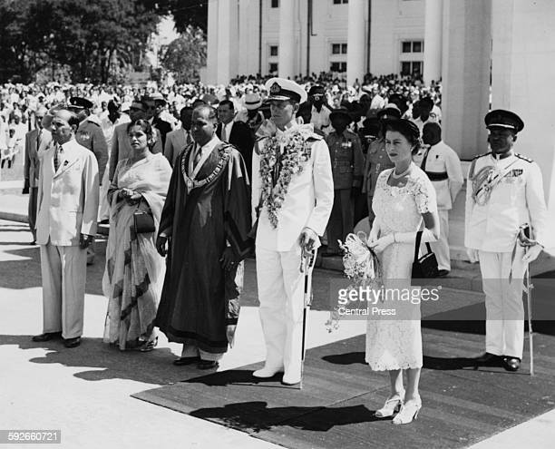 Queen Elizabeth II and the Duke of Edinburgh standing with the Mayor of Colombo Mr T Rudra as the National Anthems are played outside the Town Hall...