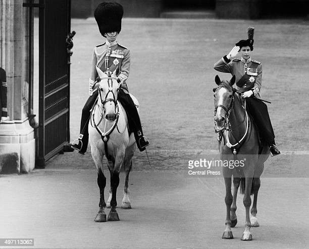 Queen Elizabeth II and the Duke of Edinburgh taking the salute outside Buckingham Palace in London during the Trooping the Colour ceremony 10th June...