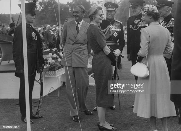 Queen Elizabeth II and the Duke of Edinburgh talking to Prime Minister Sir Anthony Eden and Lady Eden at the Bicentenary Parade of the King's Royal...