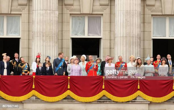 Queen Elizabeth II and the Duke of Edinburgh watch with other members of the Royal Family a flypast from the balcony of Buckingham Palace central...