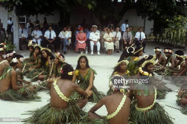 Queen Elizabeth II and the Duke of Edinburgh watching dancers performing the stickdance at King George V School in Tarawa capital of Kiribati