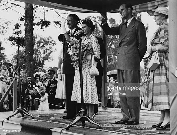 Queen Elizabeth II and the Duke of Edinburgh waving to the gathered crowd with the Mayor of Casino Alderman Manyweathers at Carrington Park New South...