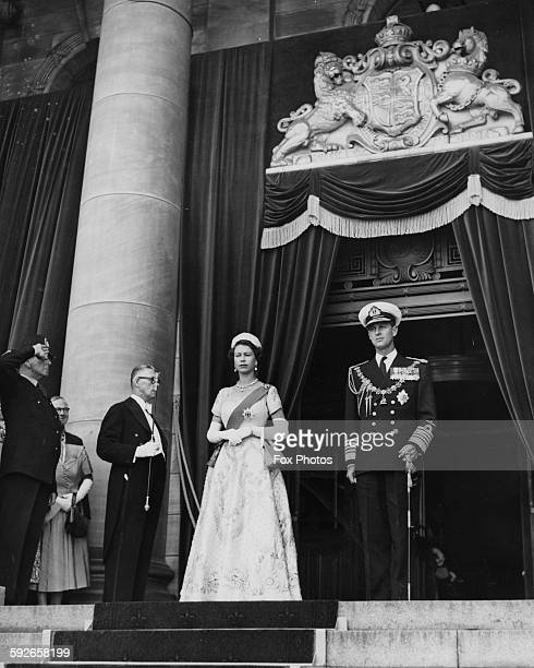 Queen Elizabeth II and the Duke of Edinburgh wearing formal dress as they leave Parliament House during their Royal Tour of Australia circa 1954
