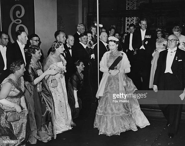 Queen Elizabeth II and the Duke of Edinburgh wearing formal dress as they leave City Hall following a Civic Ball Hobart circa 1954