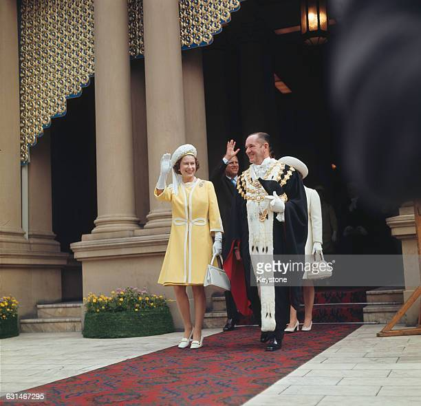 Queen Elizabeth II and the Duke of Edinburgh with Emmet McDermott Lord Mayor of Sydney in Sydney during their tour of Australia May 1970 They are...