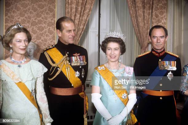 Queen Elizabeth II and the Duke of Edinburgh with Grand Duke Jean of Luxembourg and his wife Grand Duchess Josephine at a banquet given by the Grand...