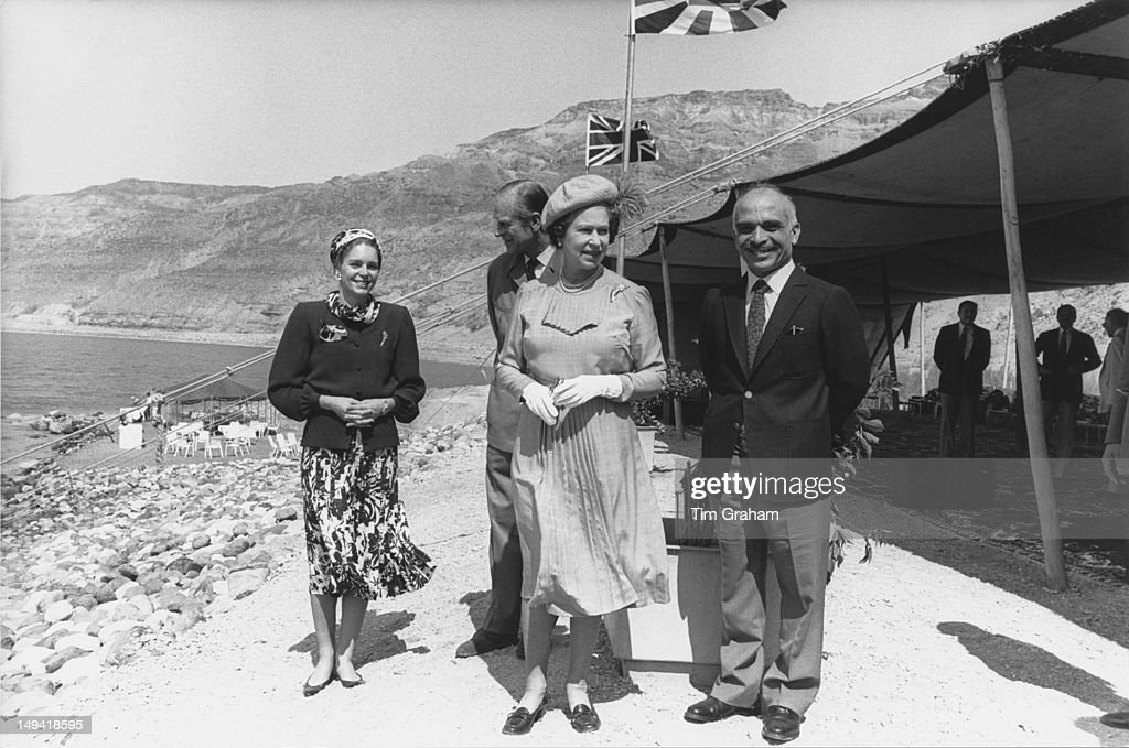 Queen Elizabeth II and the Duke of Edinburgh with King Hussein of Jordan (1835 - 1999) and Queen Noor of Jordan on the shores of the Dead Sea in Jordan, 28th March 1984.