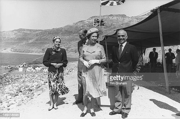 Queen Elizabeth II and the Duke of Edinburgh with King Hussein of Jordan and Queen Noor of Jordan on the shores of the Dead Sea in Jordan 28th March...