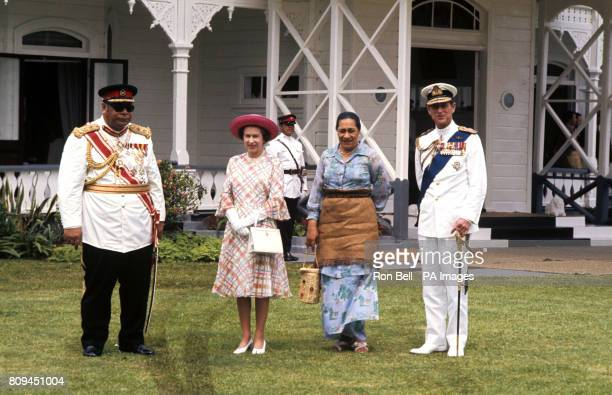 Queen Elizabeth II and the Duke of Edinburgh with King Taufa'ahau Tupou IV and Queen Halaevalu Mata'abo of Tonga at the Royal Palace, in...