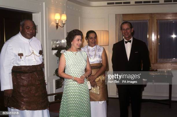 Queen Elizabeth II and the Duke of Edinburgh with King Taufa'ahau Tupou IV and Queen Halaevalu Mata'abo of Tonga when they gave a dinner party on...