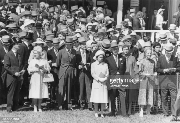 Queen Elizabeth II and the Duke of Edinburgh with members of the royal family at the Derby Epsom Downs Racecourse Surrey 2nd June 1977 At front left...