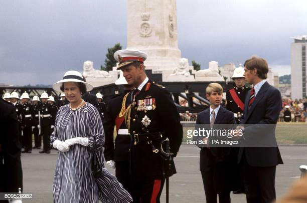 Queen Elizabeth II and the Duke of Edinburgh, with Prince Andrew and Prince Edward, when she reviewed the Royal Marines at Plymouth Hoe, during her...