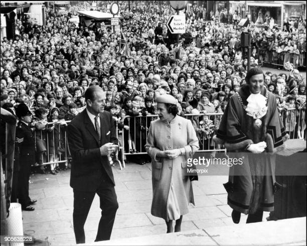 Queen Elizabeth II and The Duke of Edinburgh with the huge crowd behind them in Warrington Cheshire The local Mayor is to the left of the Queen and...