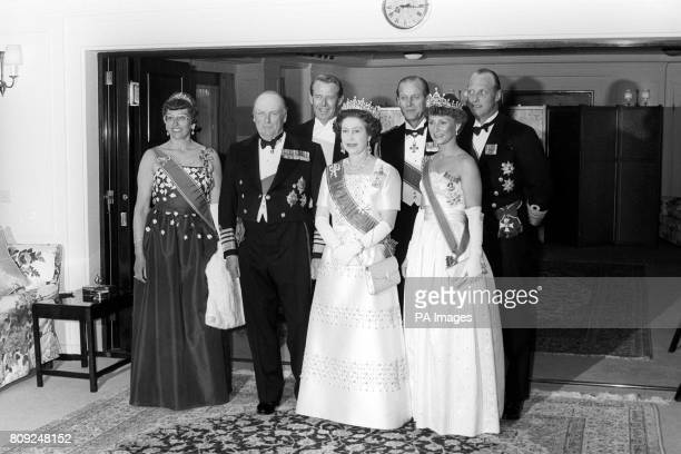 Queen Elizabeth II and the Duke of Edinburgh with the Norwegian Royal Family before going in to dinner when she hosted a State Banquet aboard the...