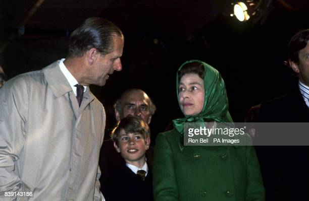 Queen Elizabeth II and the Duke of Edinburgh with their youngest son Prince Edward at Snow Hill Windsor Great Park where the Queen lit a bonfire to...