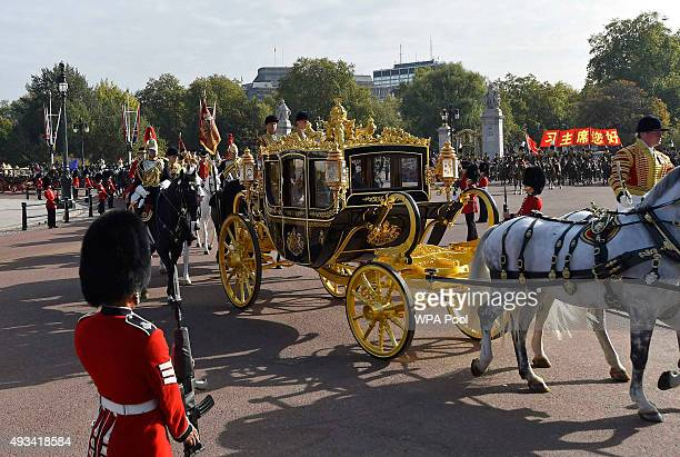 Queen Elizabeth II and the President of China Xi Jinping are driven by carriage to Buckingham Palace on October 20 2015 in London England The...