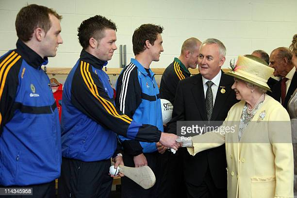 Queen Elizabeth II and the President of the GAA Christy Cooney meet with GAA sports stars Hurlers Lar Corbett and Padraic Maher from Tipperary...