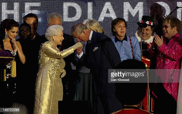 Queen Elizabeth II and The Prince of Wales on stage with artists during the Diamond Jubilee concert at Buckingham Palace on June 4 2012 in London...