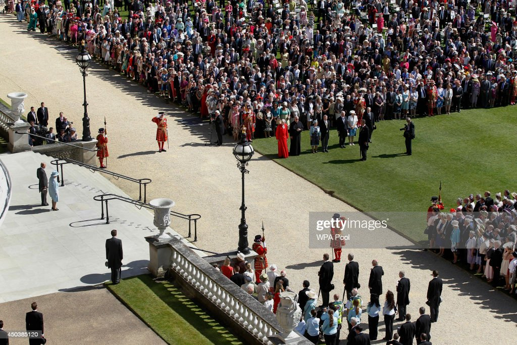 Queen Elizabeth II and the Prince Philip, Duke of Edinburgh (L) arrive for her garden party held at Buckingham Palace on June 10, 2014 in London, England.