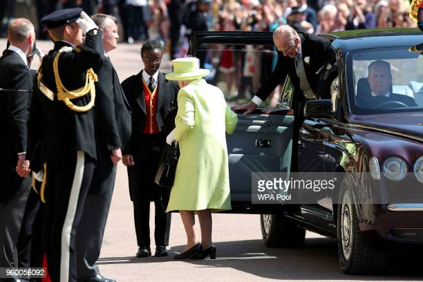 Queen Elizabeth II and the Prince Philip Duke of Edinburgh arrive for the wedding ceremony of Britain's Prince Harry and US actress Meghan Markle at...