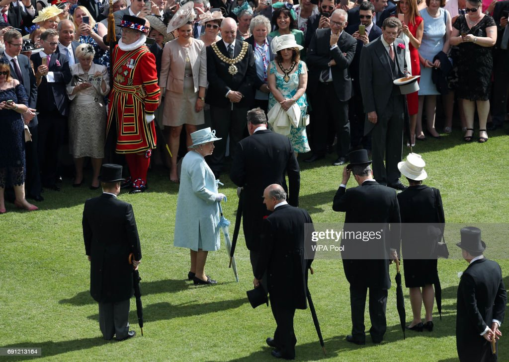 Queen Elizabeth II and the Prince Philip, Duke of Edinburgh attend a garden party at Buckingham Palace on June 1, 2017in London, England.