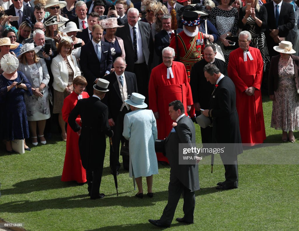 Queen Elizabeth II and the Prince Philip, Duke of Edinburgh meet members of the clergy whilst attending a garden party at Buckingham Palace on June 1, 2017in London, England.