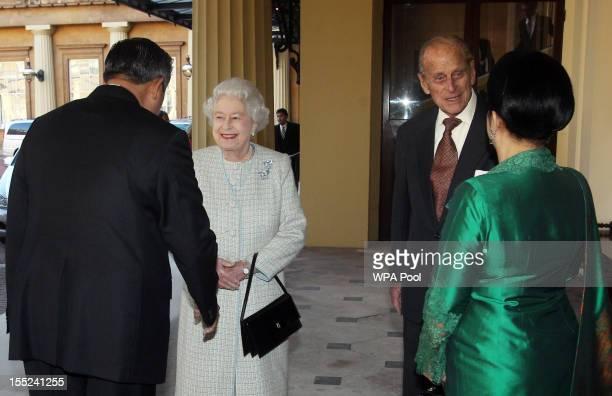 Queen Elizabeth II and the Prince Philip Duke of Edinburgh say farewell to Indonesian President Susilo Bambang Yudhoyono and his wife Ani Bambang...