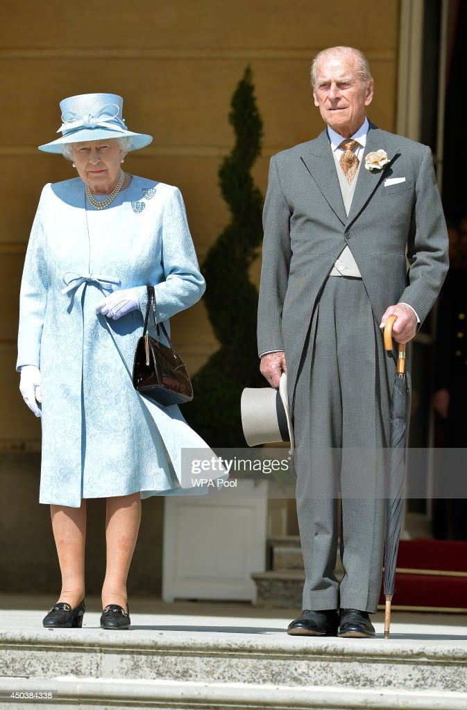 Queen Elizabeth II and the Prince Philip, Duke of Edinburgh, who is 93 years old today, stand for the national anthem a garden party held at Buckingham Palace on June 10, 2014 in London, England.
