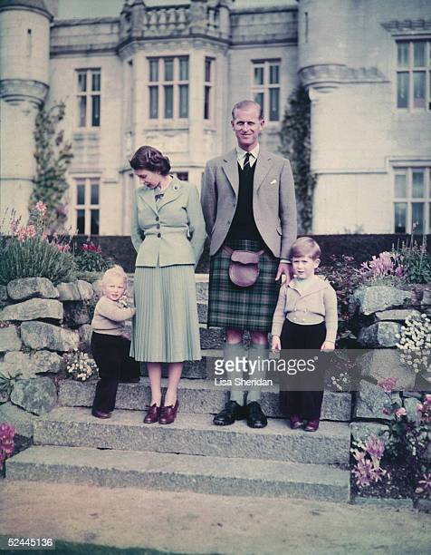 Queen Elizabeth II and The Prince Philip Duke of Edinburgh with their two young children Princess Anne and Prince Charles outside Balmoral Castle...