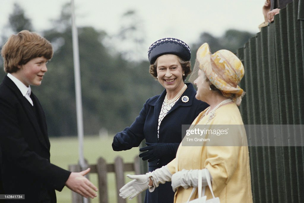 Queen Elizabeth II and the Queen Mother shake hands with Viscount Althorp, later the 9th Earl Spencer, during the Eton Boys' Tea Party at Windsor, 21st June 1978. The Viscount is the brother of Diana Spencer, the Queen's future daughter-in-law.