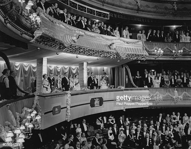 Queen Elizabeth II and the Queen Mother with other members of the Royal Family and Mohammad Reza Pahlavi Shah of Iran in the royal boxes during a...