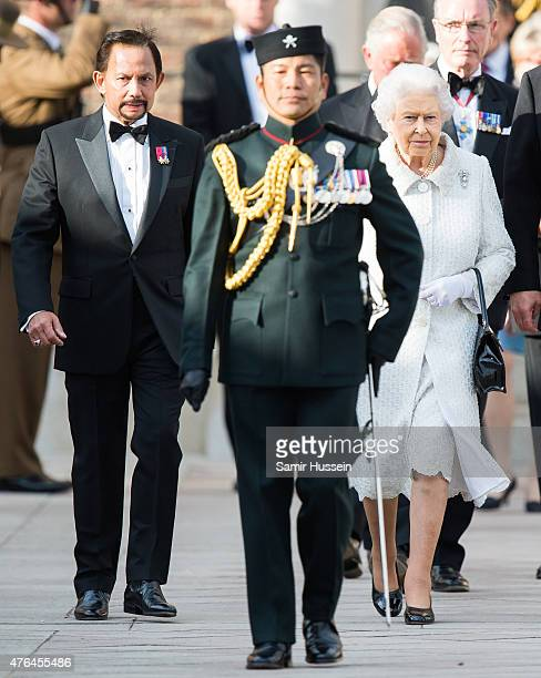 Queen Elizabeth II and The Sultan of Brunei attend the Gurkha 200 pageant at Royal Hospital Chelsea on June 9 2015 in London England