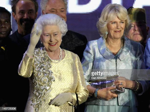 Queen Elizabeth II and the The Duchess of Cornwall on stage during the Diamond Jubilee concert at Buckingham Palace on June 4 2012 in London England...