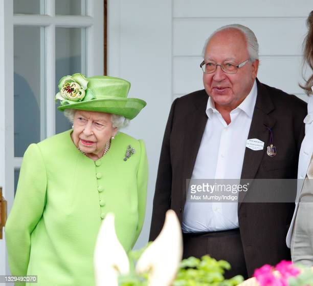 Queen Elizabeth II and Urs Schwarzenbach attend the Out-Sourcing Inc. Royal Windsor Cup polo match and a carriage driving display by the British...