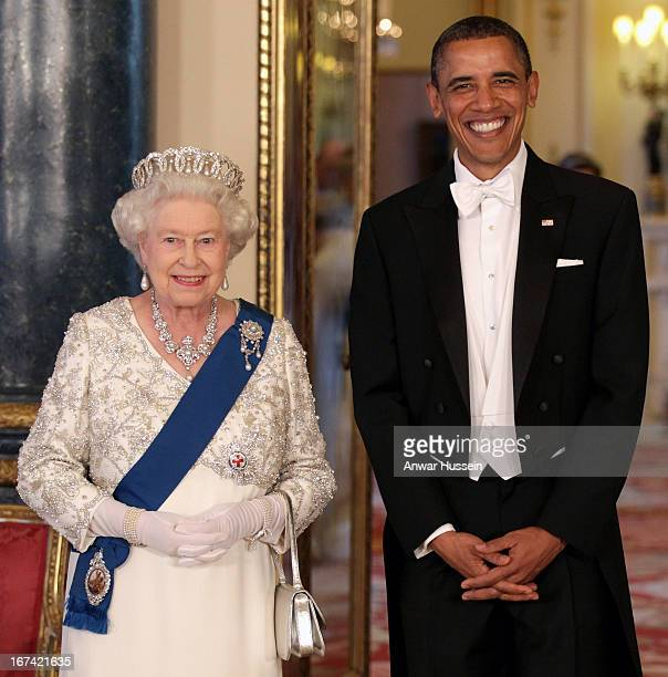 Queen Elizabeth II and US President Barack Obama arrive for a State Banquet at Buckingham Palace on May 24 2011 in London England
