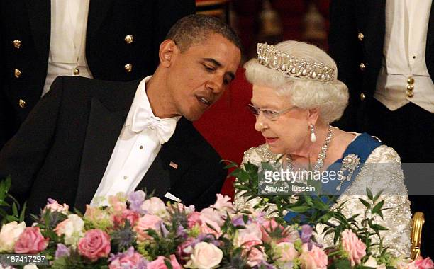 Queen Elizabeth II and US President Barack Obama chat together during a State Banquet at Buckingham Palace on May 24 2011 in London England *