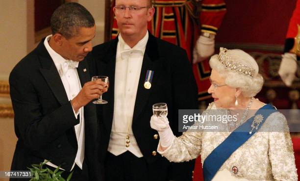 Queen Elizabeth II and US President Barack Obama toast each other during a State Banquet at Buckingham Palace on May 24 2011 in London England *
