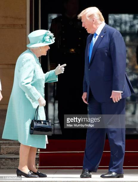 Queen Elizabeth II and U.S. President Donald Trump attend the Ceremonial Welcome in the Buckingham Palace Garden for President Trump during day 1 of...
