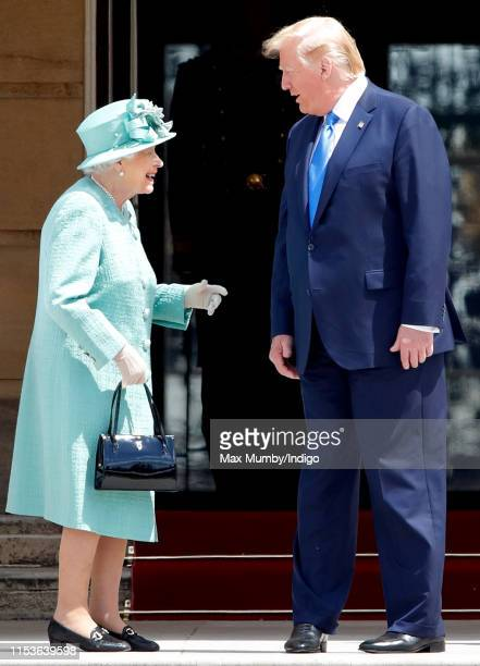 Queen Elizabeth II and US President Donald Trump attend the Ceremonial Welcome in the Buckingham Palace Garden for President Trump during day 1 of...