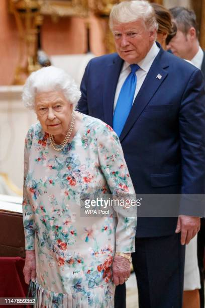 Queen Elizabeth II and US President Donald Trump view displays of US items of the Royal collection at Buckingham Palace on June 3 2019 in London...