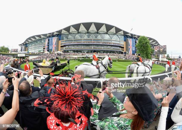 Britain's Queen Elizabeth II watches the Wolferton Rated Stakes race on day one of the Royal Ascot horse racing meet in Ascot west of London on June...
