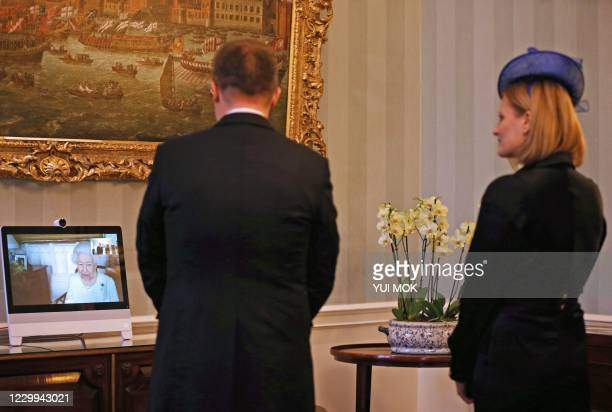 Queen Elizabeth II appears on a screen by videolink from Windsor Castle, during a virtual audience to receive His Excellency Dr. Ferenc Kumin,...