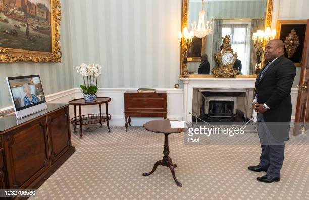 Queen Elizabeth II appears on a screen via videolink from Windsor Castle, where she is in residence, during a virtual audience to receive the...
