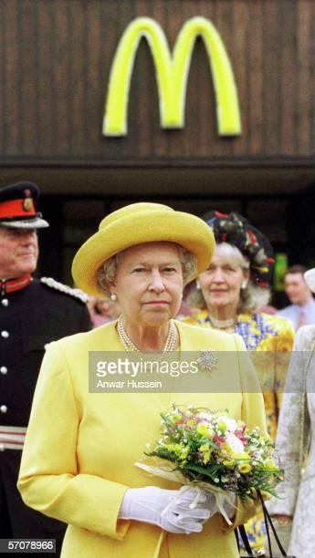 Queen Elizabeth II arrives at a McDonald's drive-thru restaurant on a visit to Chesire Oaks Designer outlet in Ellesmere Port on July 31st 1998 in...
