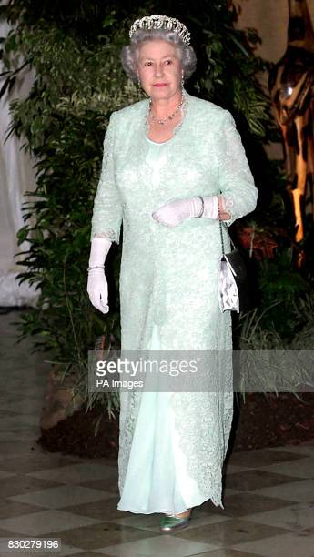 Queen Elizabeth II arrives at a state banquet in Pretoria South Africa hosted by President Thabo Mbeki and attended by former President Nelson...